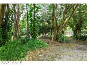 RARELY OFFERED...... .86 ACRES OF MATURE GARDEN WITH TOTAL PRIVACY......LARGE OUTDOOR LIVING WITH POOL THAT IS SCREEN ENCLOSED.......EXCELLENT LOCATION CLOSE TO BEACH, SHOPPING, MARINAS, RESTAURANTS, MERCATO, AND MUCH MORE......HOME FEATURES AN UPDAT...