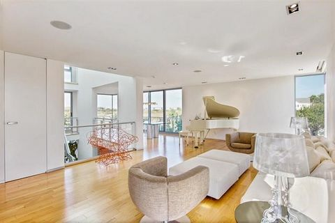 This contemporary beach home was designed by Manhattan-based Italian star architect Leopoldo Rosati. High-end custom details characterize the modern 5 bedroom, 4.5 bath beach house. An abundance of natural light pours into the home, thanks to oversiz...