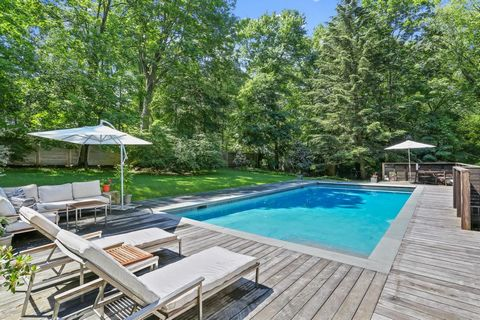 Stunning modern, mid-century inspired home seamlessly blends indoor and outdoor lifestyles. Custom designed and completely rebuilt by the current owner, an award winning photographer to exacting standards creating environmentally friendly, open conce...