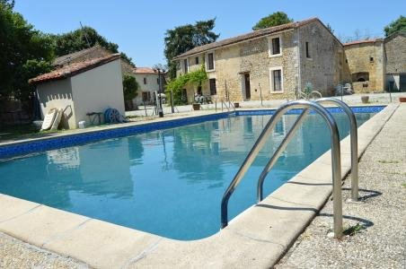 Our ref- AI4814 Currently run as a gîte business, this unique large gîte complex (self-catering holiday complex), has five good sized cottages, plus a large farmhouse which is currently divided into two separate houses, both with lovely south-facing ...