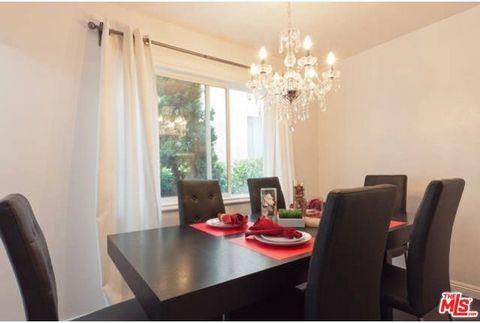 This stunning newly remodeled Contemporary condo with open floor plan. Brand new kitchen with all new white lacquered cabinets. Hardwood floors throughout. Renovated bathroom and fixtures. Great Santa Monica location just steps from Bristol Farms. Wi...