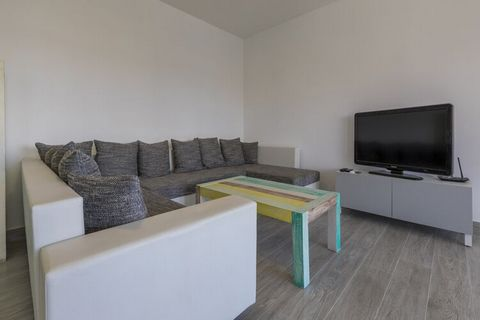 This spacious apartment with pool and covered private terrace is located in Dramalj. Ideal for a small group, guests can take a dip in the shared swimming pool and access free WiFi at this property. You can walk down to the beach, 380 m away, where y...