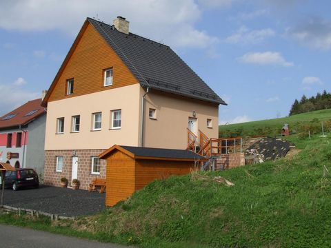 This apartment is part of a house containing two apartments. It is situated at an altitude of 1050 meters, at the foot of the highest mountain in the Ore Mountains, the Klínovec (1244 m). The house lies at the entrance to the village of Haj. The moun...