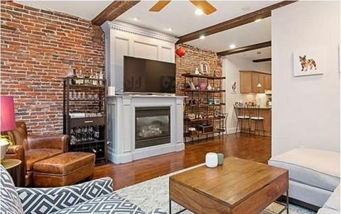 A large one bedroom condo located in the heart of the North End. This unit has a wonderful open floor plan that lends itself to entertaining and convenient living. The lovely, spacious living room, with a wall of windows and a stunning gas fire place...